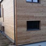 Holzfassade über Erd- und Obergeschoß
