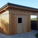 Gartenhütte mit überdachten Müllplatz
